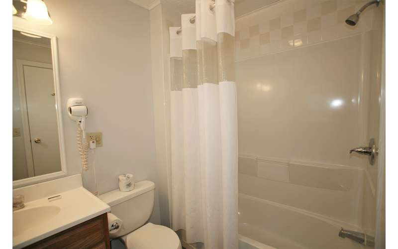 the bathroom with shower, toilet, sink