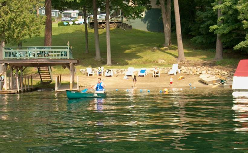 person in rowboat rowing away from the property