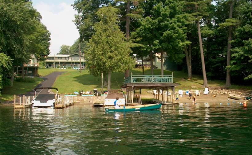 view of property, beach, boats, from the water