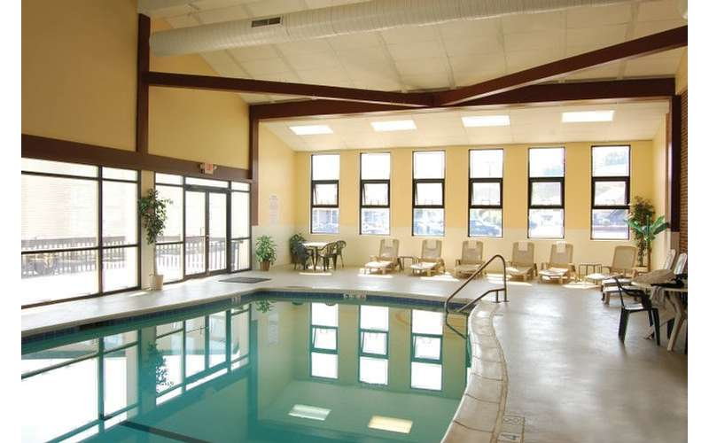 a large indoor pool with chairs along one side