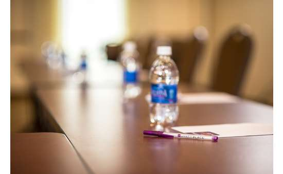close-up view of water bottle with pen and notepad