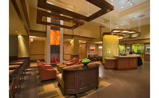 larger view of lobby showing seating areas and front desk from another angle
