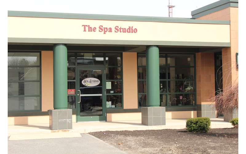 Entrance of The Spa Studio in a plaza