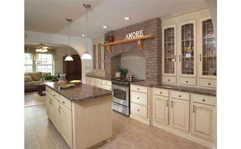 kitchen with a large island and brick accents above the stove