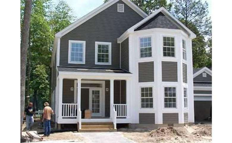 exterior of a new house with bay windows on the first and second stories