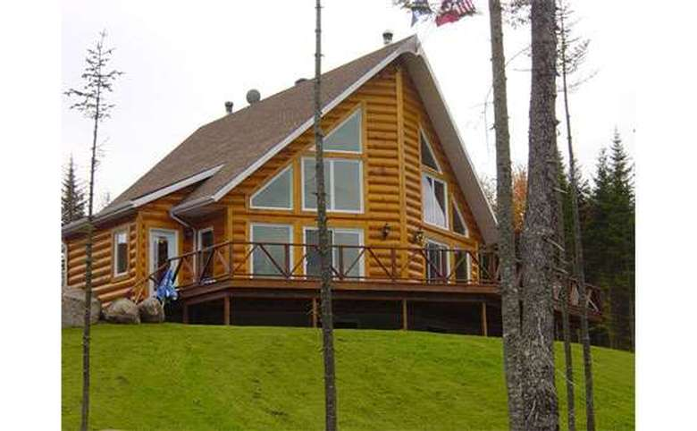 log home with large windows