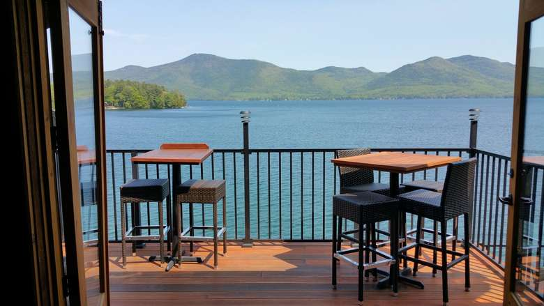tables on a patio overlooking lake george
