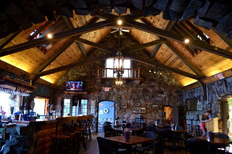 restaurant dining room with high wooden ceilings