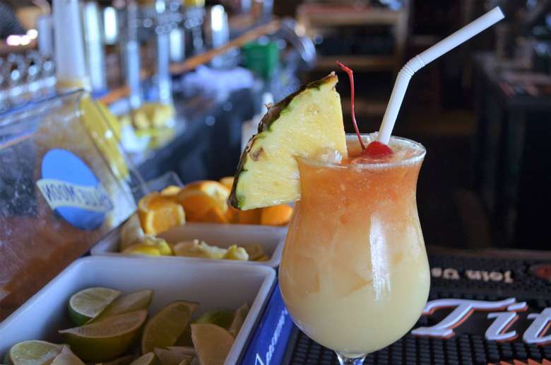 tropical beverage with a pineapple garnish
