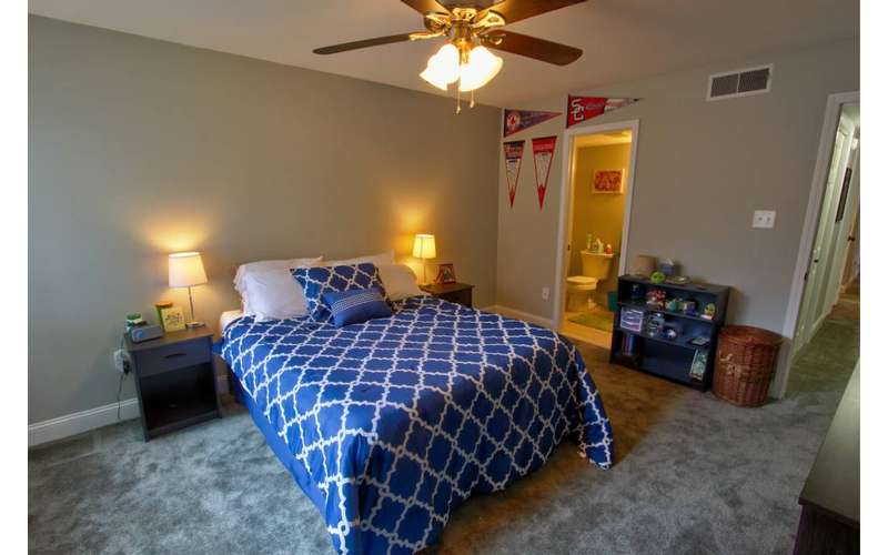 blue bed in a bedroom