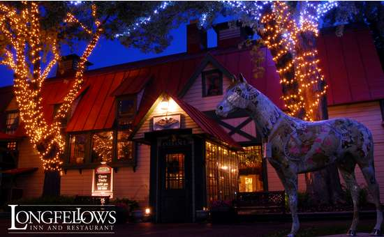exterior of longfellows at dusk with christmas lights on the trees