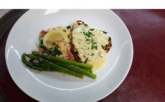 swordfish on top of risotto with lemon and asparagus