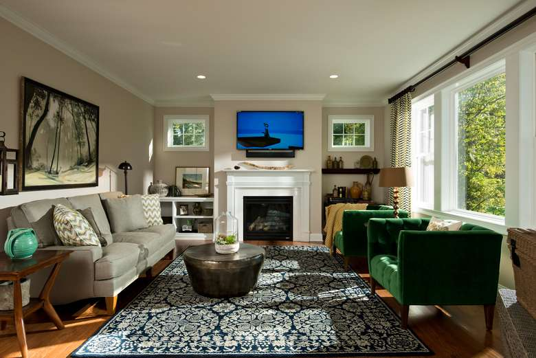 family room with a large window, a fireplace, and a flat screen tv