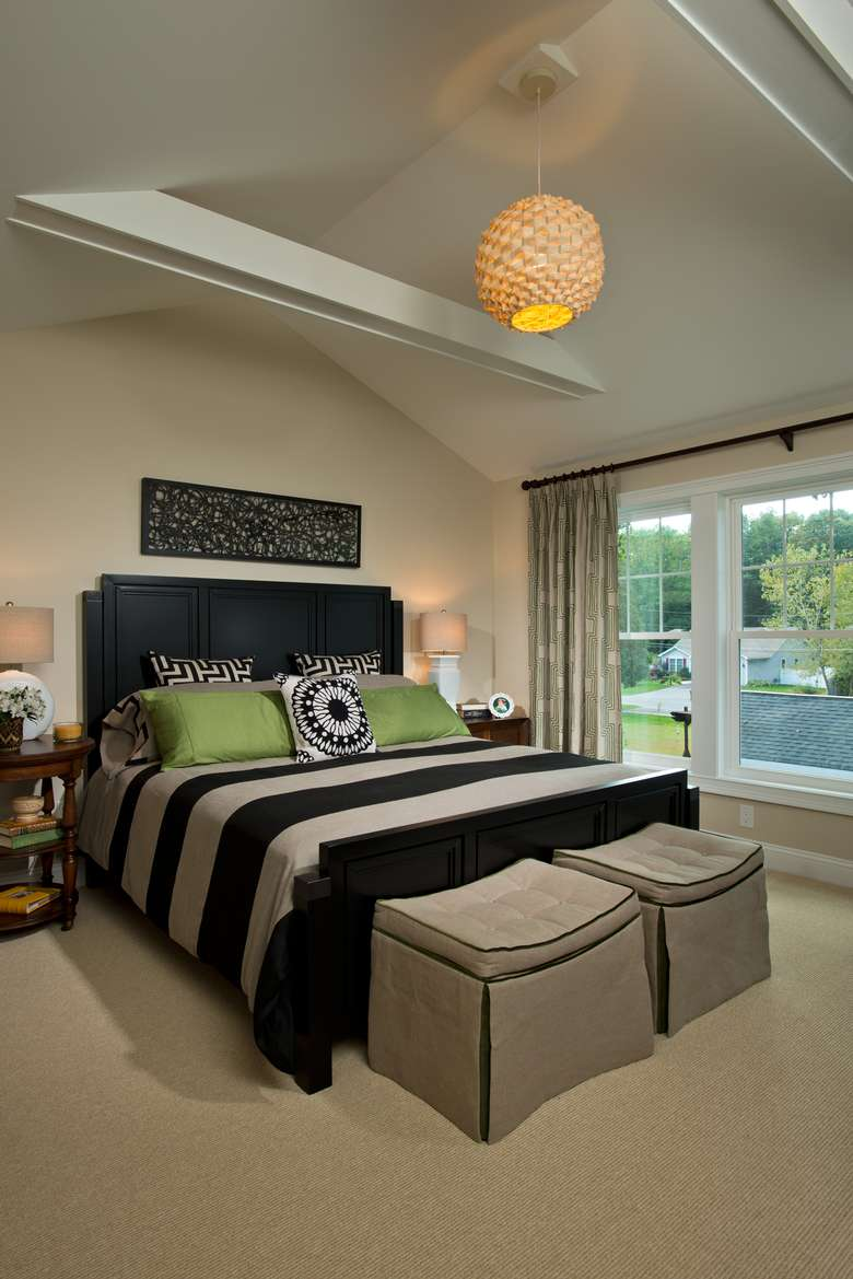 master bedroom with a king-size bed and vaulted ceiling