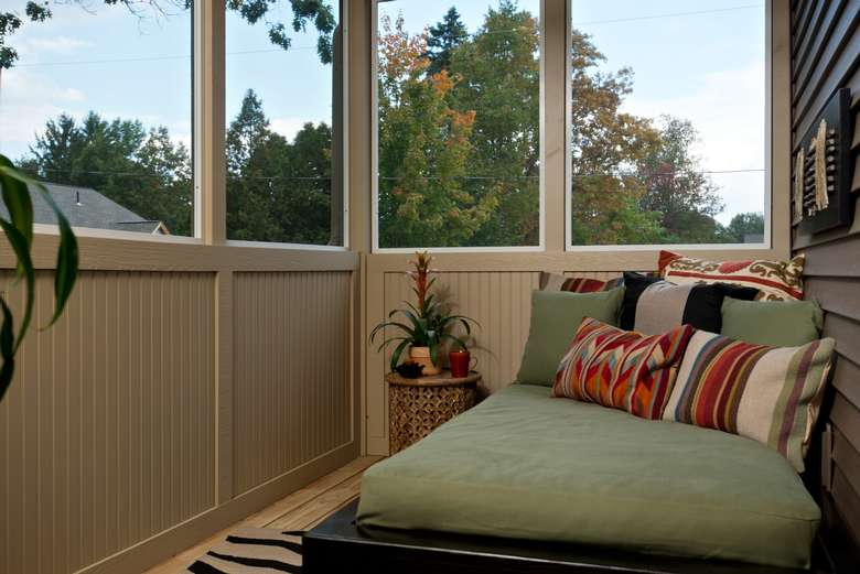 screened-in porch with a wide chaise lounge