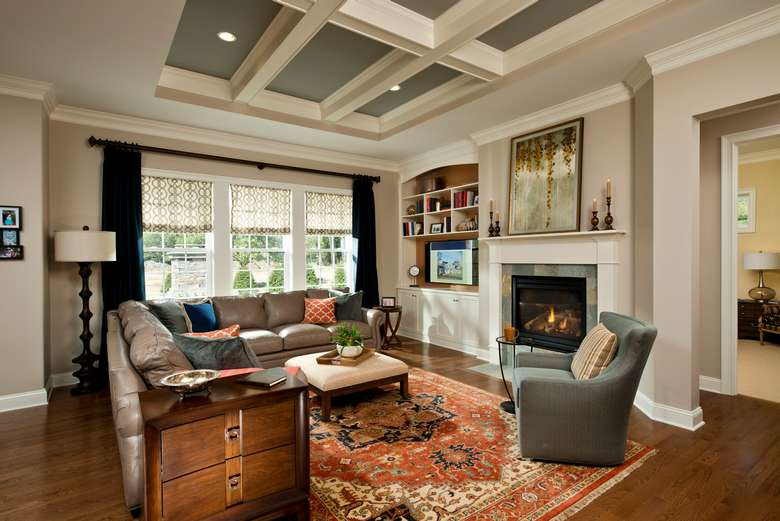 family room with comfortable seating, a fireplace, and decorative beams on the ceiling