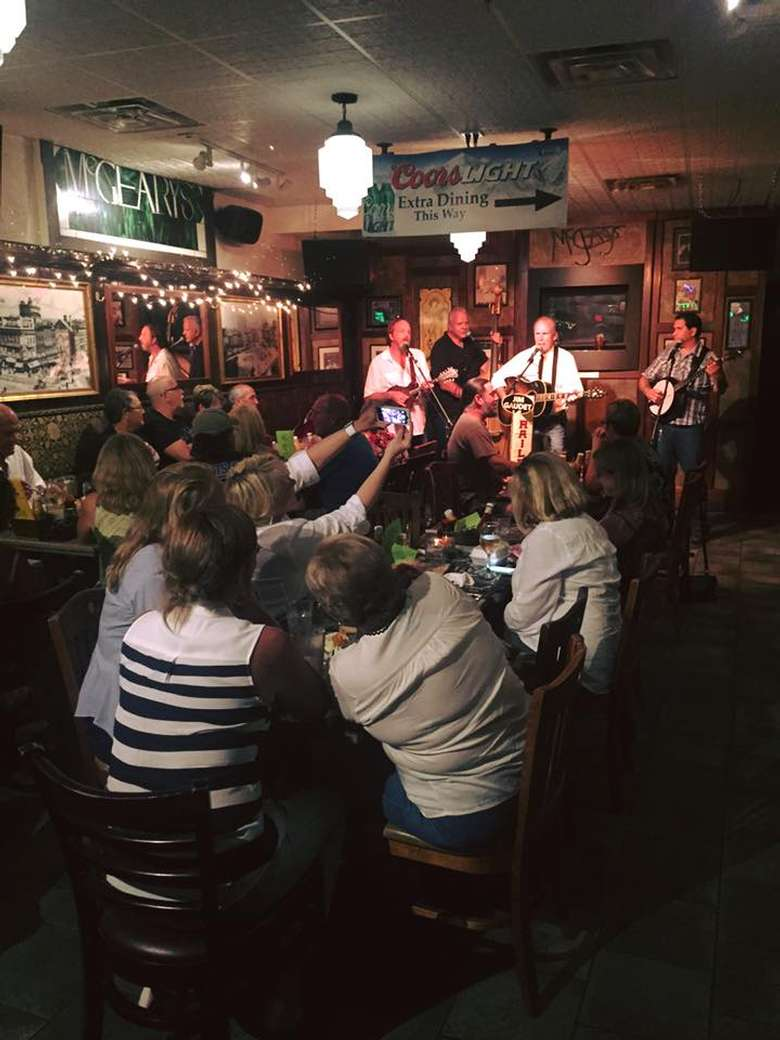 a band playing in the bar