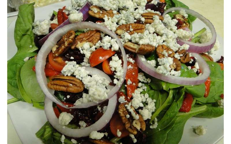a salad with nuts and feta cheese