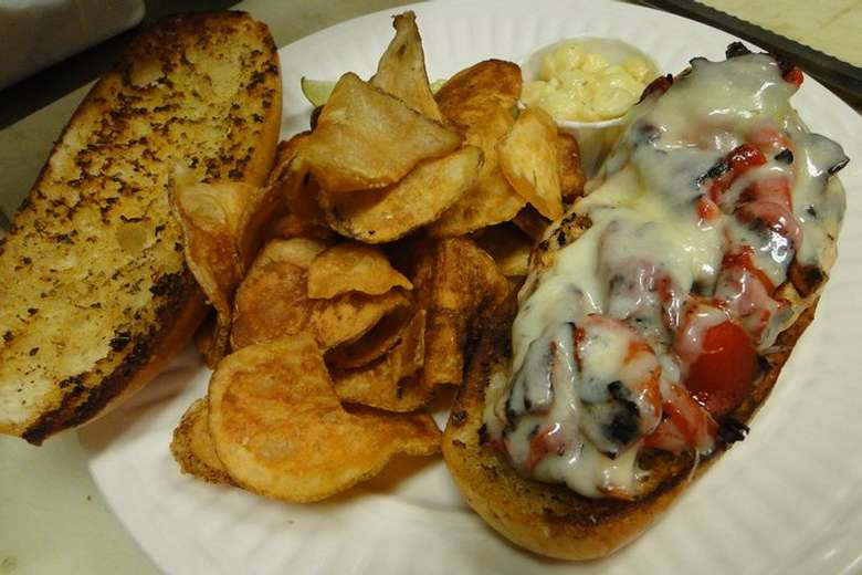 an open face sandwich with chips