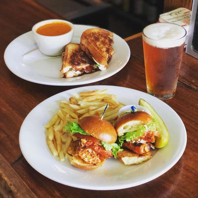 plates of food with a beer