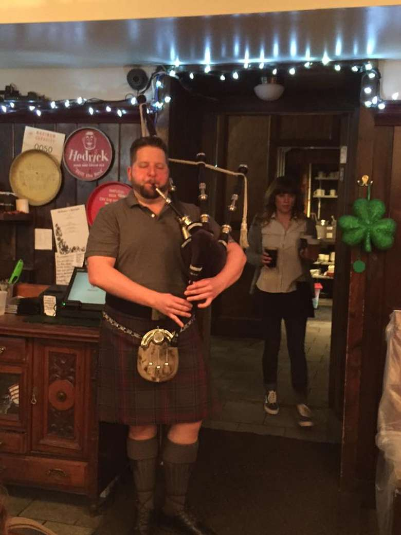 a man playing a bagpipe