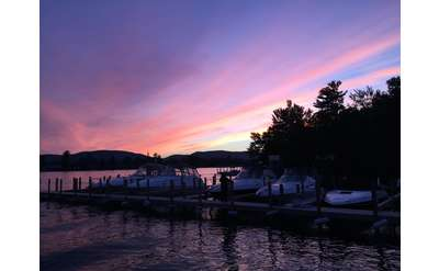 purple and pink sky during evening over a marina