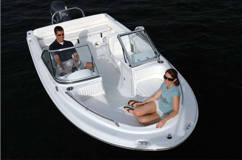 two people inside a small motorboat