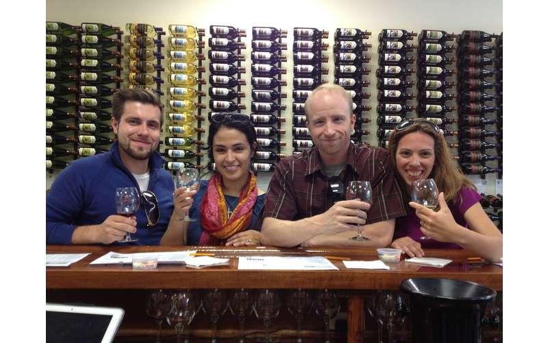 four wine tasters