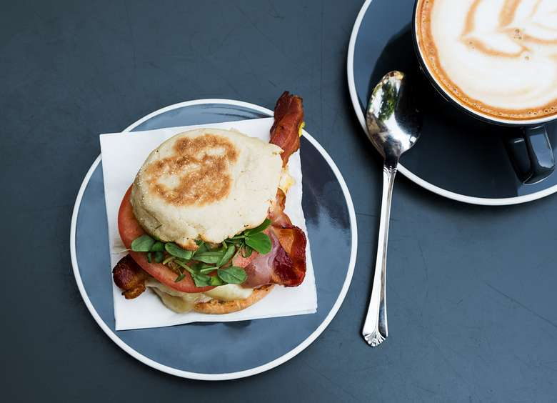 coffee and breakfast sandwich