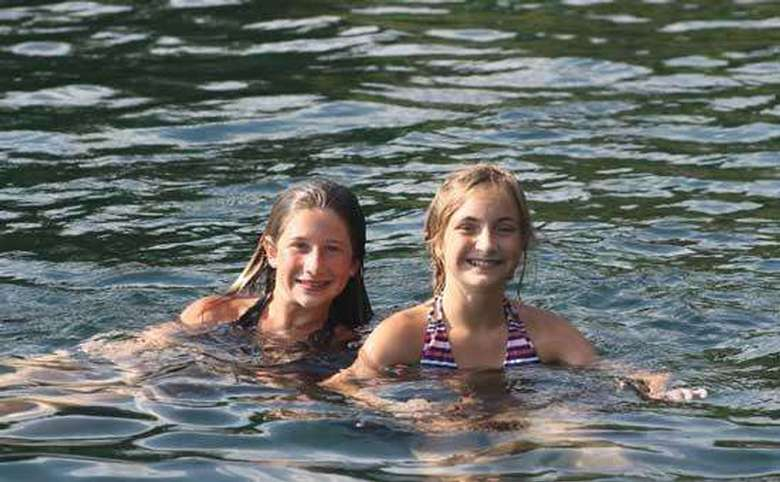 two little girls swimming
