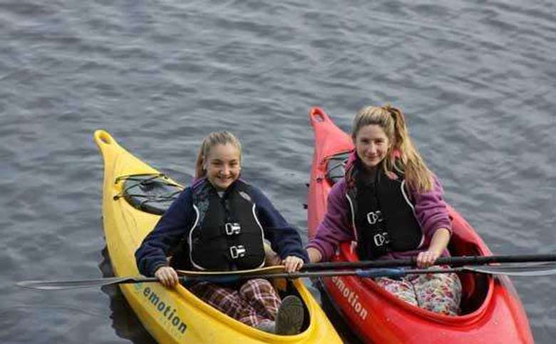 two young girls in kayaks