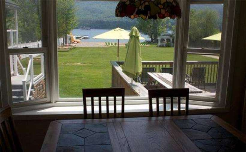 view of property and lake from a window