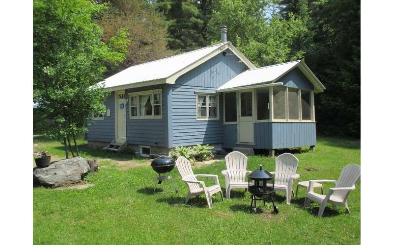 a light blue cottage named Pohjan Tupa