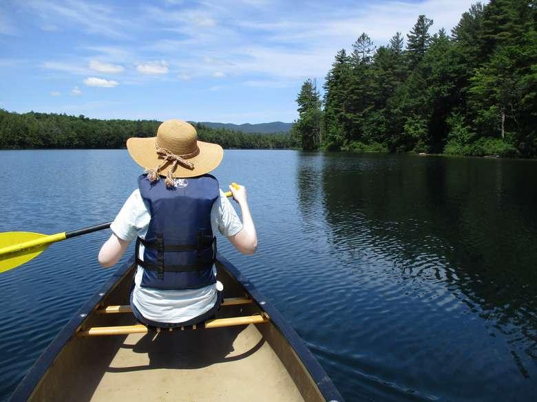 woman kayaks
