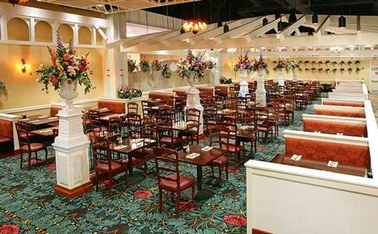 large restaurant with tables, chairs, and booths