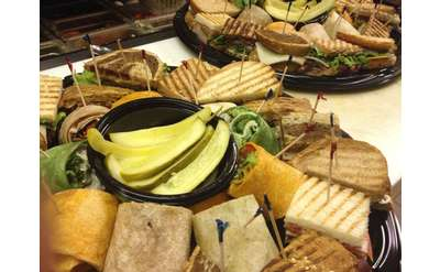 Various sandwiches and wraps on large plater