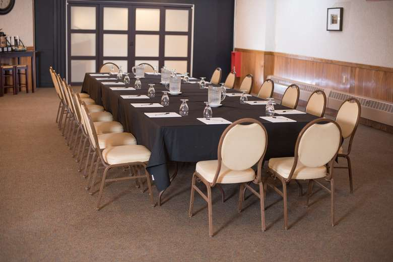 meeting table with dozens of chairs
