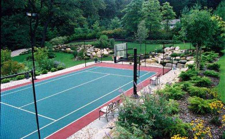 large green court that can be used for basketball and tennis
