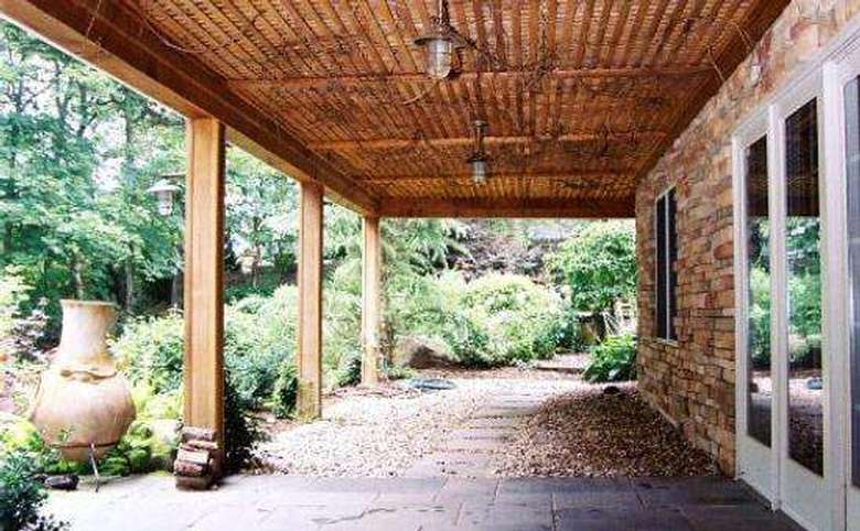 the back patio of a stone house
