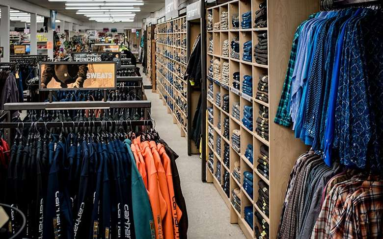rows of carhartt clothing in a store