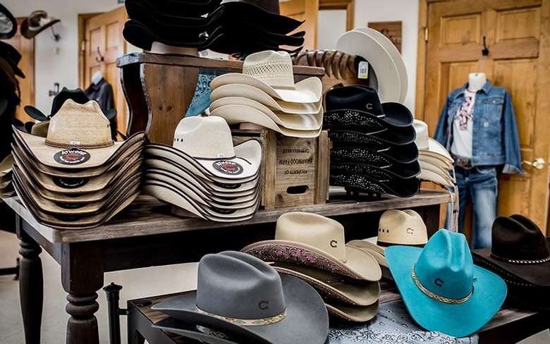 a table with western hats on display