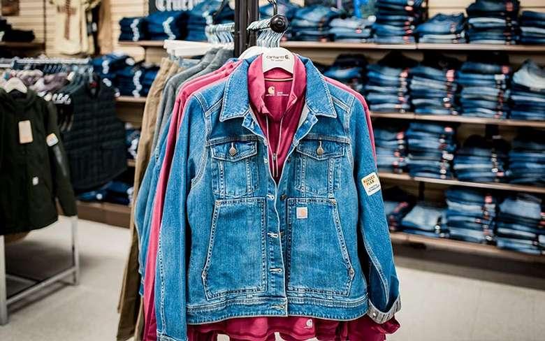 women's carhartt clothing on a rack