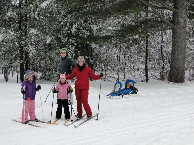 a family of four on skis