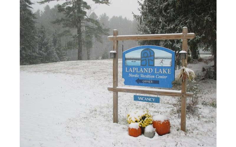 a sign in the snow of Lapland Lake