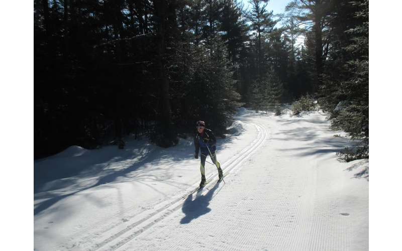 one person cross-country skiing who looks like a professional
