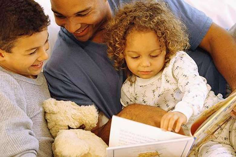 Kids reading with adult