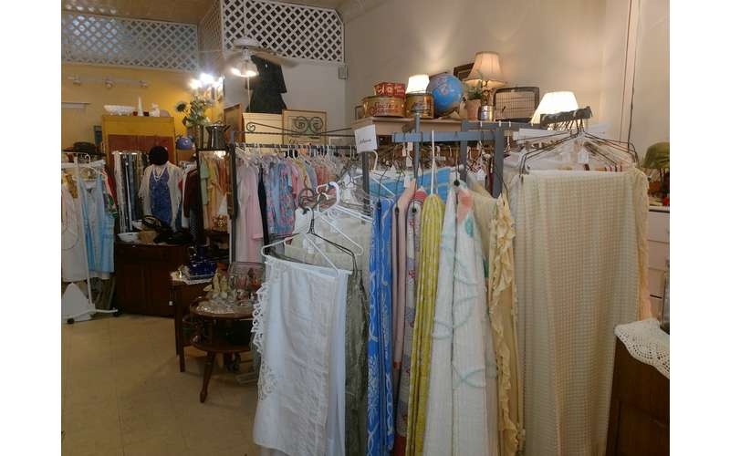 vintage shirts and clothing on racks in a store