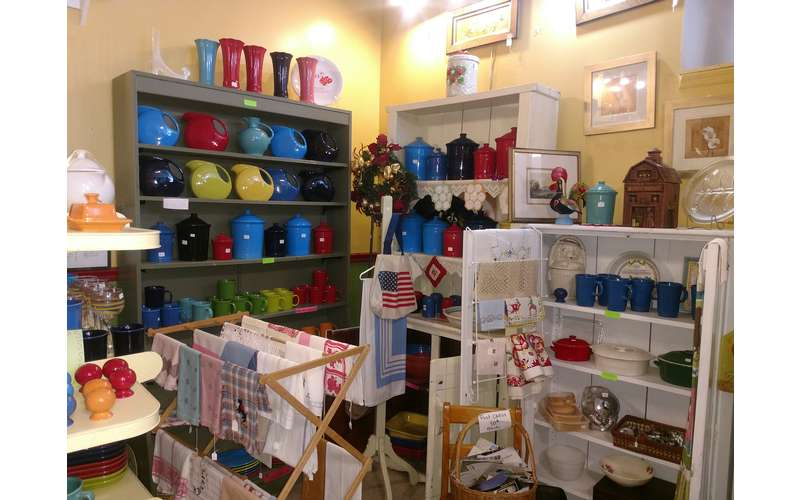 shelves of products such as fiestaware and cups