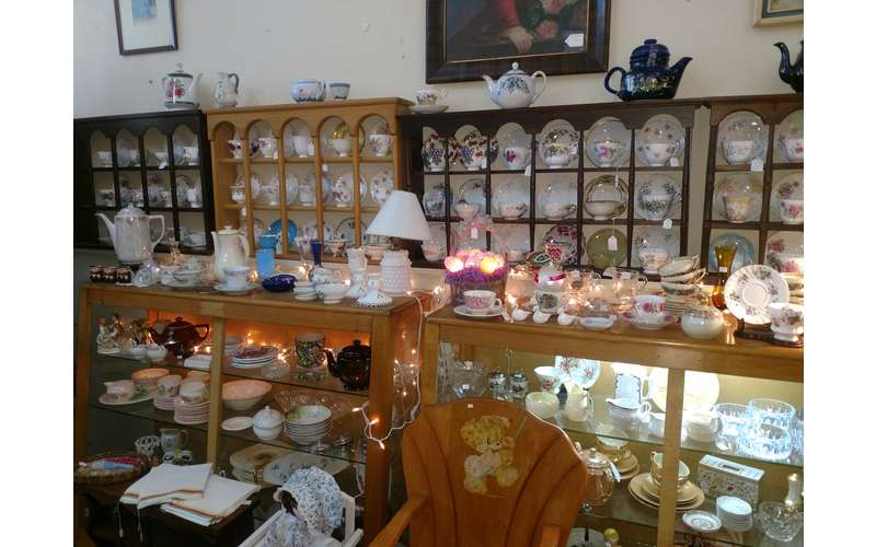a wide range of teacups, bowls, and plays on display
