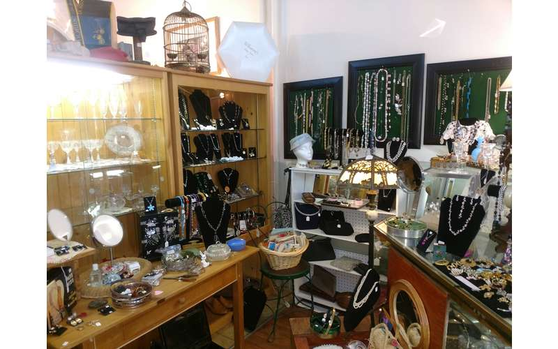 necklaces and other jewelry in display cases and on shelves